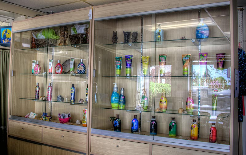 Selection of our tanning products inside glass cases